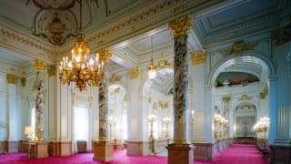 A photo of the great hall on the second floor. Large marble pillars with beautiful purple patterns can be seen.