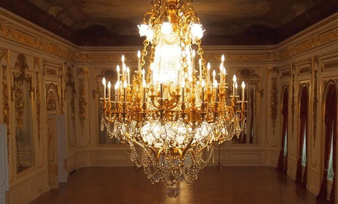 A large chandelier made up primarily of crystals hangs from the ceiling.