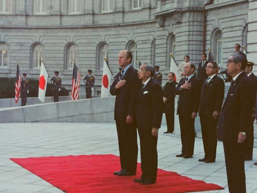 President Ford and Emperor Showa listen to national anthems during the farewell ceremony in the front garden