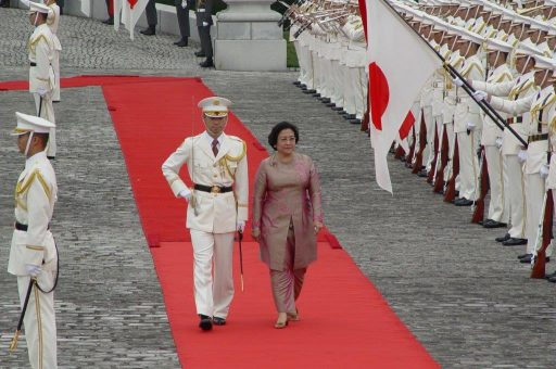 President Megawati walks on the red carpet led by a commanding officer during the welcome ceremony in the front garden