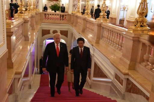 Prime Minister Abe and President Trump go up the main stairs for their Summit Meeting.